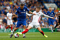 Mateo Kovačić of Chelsea is tackled by Oliver Norwood of Sheffield United during the Premier League match between Chelsea and Sheff United at Stamford Bridge, London, England on 31 August 2019. Photo by Carlton Myrie / PRiME Media Images.