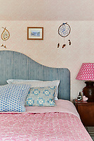 The master bedroom has a romantic, feminine feel decorated in various shades of pink with all fabrics by Molly Mahon.