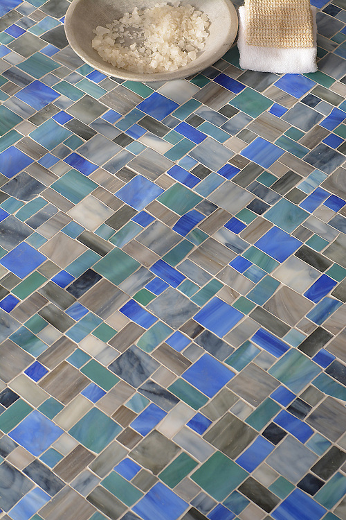 Garden Party, a handmade mosaic shown in Lavastone, Zircon, Tourmaline, and Peacock Topaz Sea Glass™, is part of the Sea Glass™ collection by New Ravenna.