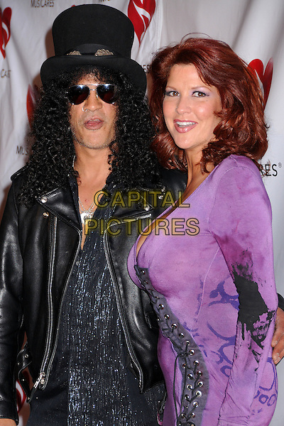SLASH & PERLA FERRAR.4th Annual MusiCares MAP Fund Benefit Concert at the Music Box Theatre, Hollywood, California, USA..May 9th, 2008.half length black jacket top hat leather sunglasses shades purple dress married husband wife .CAP/ADM/BP.©Byron Purvis/AdMedia/Capital Pictures.