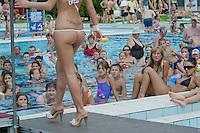 Viewers watch Petra Viktoria Ihasz attend the Miss Bikini Hungary beauty contest held in Budapest, Hungary on August 06, 2011. ATTILA VOLGYI