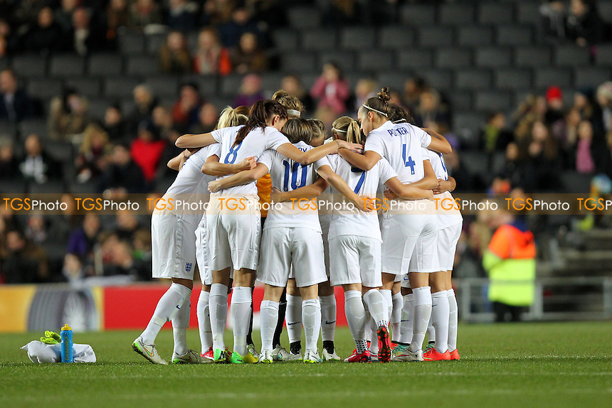 England players huddle ahead of kick-off - England Women vs USA Women - International Football Friendly Match at Stadium MK, Milton Keynes Dons FC - 13/02/15 - MANDATORY CREDIT: Gavin Ellis/TGSPHOTO - Self billing applies where appropriate - contact@tgsphoto.co.uk - NO UNPAID USE