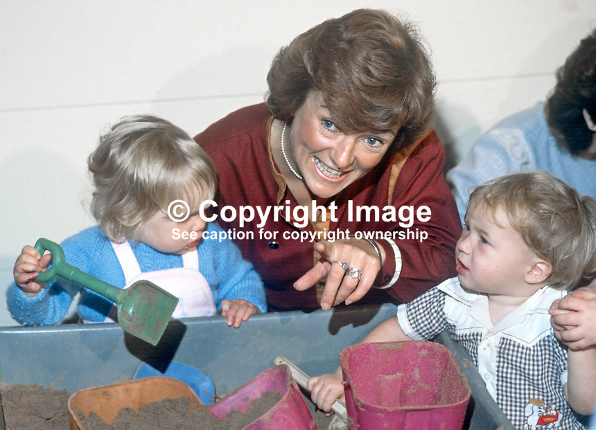 Glenys Kinnock, wife of Neil Kinnock, MP, leader, Labour Party, UK, visits creche at annual conference, October, 1984, 19840122GK1.<br /> <br /> Copyright Image from Victor Patterson, 54 Dorchester Park, <br /> Belfast, UK, BT9 6RJ<br /> <br /> t1: +44 28 9066 1296 (from Rep of Ireland 048 9066 1296)<br /> t2: +44 28 9002 2446 (from Rep of Ireland 048 9002 2446)<br /> m: +44 7802 353836<br /> <br /> e1: victorpatterson@me.com<br /> e2: victorpatterson@gmail.com<br /> www.victorpatterson.com<br /> <br /> Please see my Terms and Conditions of Use at www.victorpatterson.com. It is IMPORTANT that you familiarise yourself with them.<br /> <br /> Images used on the Internet must be visibly watermarked i.e. &copy; Victor Patterson<br /> within the body of the image and copyright metadata must not be deleted. Images <br /> used on the Internet have a size restriction of 4kbs and will be chargeable at current<br />  NUJ rates unless agreed otherwise.<br /> <br /> This image is only available for the use of the download recipient i.e. television station, newspaper, magazine, book publisher, etc, and must not be passed on to any third <br /> party. It is also downloaded on condition that each and every usage is notified within 7 days to victorpatterson@me.com<br /> <br /> The right of Victor Patterson to be identified as the author is asserted in accordance with The Copyright Designs And Patents Act (1988). All moral rights are asserted.