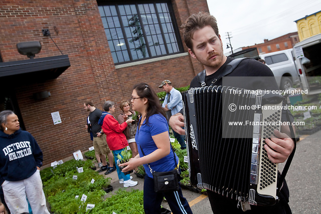 A man plays the accordion in Detroit Eastern Farmers market in Detroit (Mi) Saturday June 8, 2013. The largest open-air flowerbed market in the United States, the Eastern Market is a historic commercial district in Detroit, Michigan.