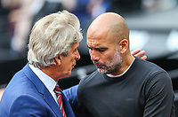 Manuel Pellegrini (Manager) of West Ham United and Pep Guardiola (Manager) of Manchester City during the Premier League match between West Ham United and Manchester City at the London Stadium, London, England on 10 August 2019. Photo by David Horn.