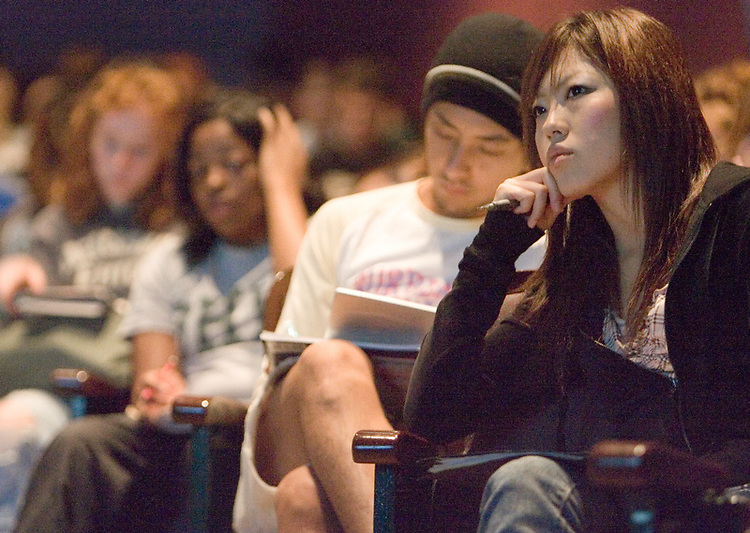 Student Yuka Nakagawa (right) and other students and guests fill Memorial Auditorium for the Scripps College of Communication Celebration.