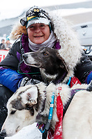 Jessie Royer is all smiles as she congratulates her lead dogs Seal and Striker shortly after crossing the finish line in Nome to place 3rd in the 2019 Iditarod sled dog race.<br /> <br /> Photo by Jeff Schultz/  (C) 2019  ALL RIGHTS RESERVED