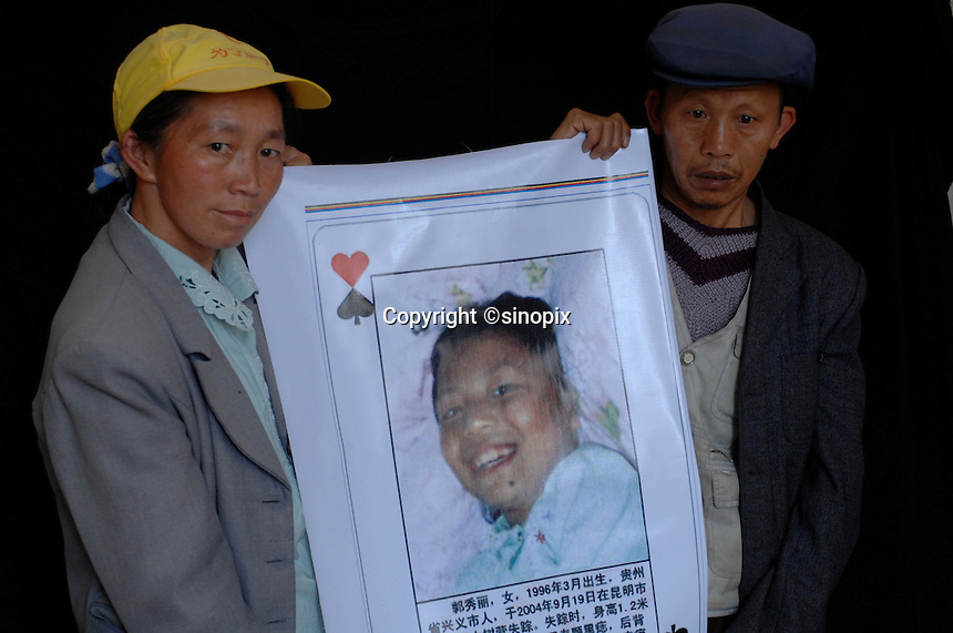 Li Ren Xiu, 39, (L) and Guo Cheng Fu, 49 (R) hold a poster of Guo Xiu Li, who was eight and half years old when she was stolen from her parents house. She was stolen in September 2004 and despite their best efforts their parents have been unable to find her. Her mother, Li Ren Xiu, 39, holds the photograph, June 2007. The trade in girls and women is increasing as the sex imbalance has reached a national average of 120 males for every 100 females, in some areas the ratio is as high as 168 males for every 100 females..PHOTO BY SINOPIX
