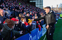 Lincoln City's Shay McCartan gives away a Kick It Out t-shirt to a young fan at half time<br /> <br /> Photographer Chris Vaughan/CameraSport<br /> <br /> The EFL Sky Bet League Two - Lincoln City v Northampton Town - Saturday 9th February 2019 - Sincil Bank - Lincoln<br /> <br /> World Copyright &copy; 2019 CameraSport. All rights reserved. 43 Linden Ave. Countesthorpe. Leicester. England. LE8 5PG - Tel: +44 (0) 116 277 4147 - admin@camerasport.com - www.camerasport.com