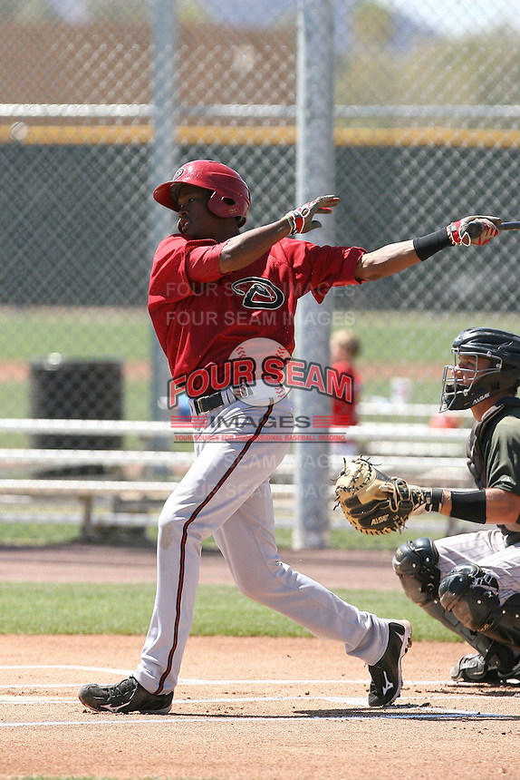 Keon Broxton #32 of the Arizona Diamondbacks plays in a minor league spring training game against the Colorado Rockies at the Rockies minor league complex on April 1, 2011  in Scottsdale, Arizona. .Photo by:  Bill Mitchell/Four Seam Images.