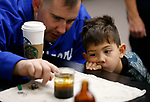 Easton Ledbetter, 4, and his dad Brett learn about density at the Boo-nanza event at the Carson City Library, in Carson City, Nev., on Tuesday, Oct. 30, 2018. <br /> Photo by Cathleen Allison/Nevada Momentum