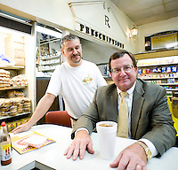 Lunch counter manager Don Pinney visits with regular customer, Ron Merritt at Sutton's Drugstore.