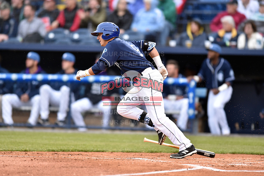 Asheville Tourists catcher Dom Nunez (9) runs to first during a game against the Greenville Drive on April 16, 2015 in Asheville, North Carolina. The Tourists defeated the Drive 5-4. (Tony Farlow/Four Seam Images)