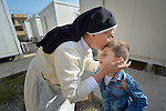 Dominican Sister St. Elene kisses 4-year old Luis Firas as he goes off to a church-run preschool in Ankawa, Iraq. The nun, and the boy's family, were all displaced from Mosul by ISIS in 2014. The sister is a member of the Dominican Sisters of St. Catherine of Siena.