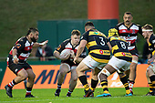 Conan O'Donnell takes on Donald Brighouse and Pita-Gus Sowakula. Mitre 10 Cup rugby game between Counties Manukau Steelers and Taranaki Bulls, played at Navigation Homes Stadium, Pukekohe on Saturday August 10th 2019. Taranaki won the game 34 - 29 after leading 29 - 19 at halftime.<br /> Photo by Richard Spranger.