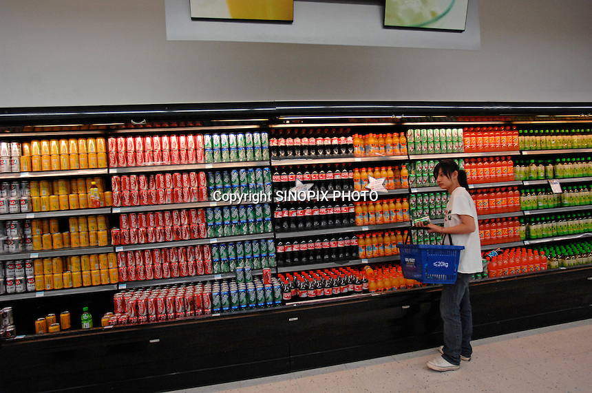 The soft drinks refridgerator at Wal-mart in Nanning, China. Wal-Mart sets its international focus on China and India in 2007 as U.S. sales withered, and the retailer stated this week that 2007 year-to-date sales at most of its stores in China have outpaced sales from the competition by two to three times..11 Dec 2007