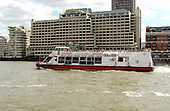 "London, England, GBR - August 7, 2005 -- A ""City Cruise"" ship carrying tourists moves down the Thames River in London, GBR on August 7, 2005.  The boats move between Westminister Docks and Greenwich on a regular schedule..Credit: Ron Sachs / CNP"