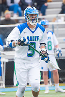 Eric Backus,'17, follows game action as the Seahawks battle Roger Williams in Men's Lacrosse game action at Gaudet Field in Middletown.
