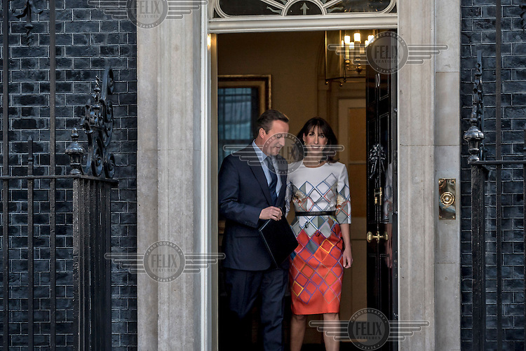 Prime Minister David Cameron, accompanied by his wife Samantha, exits number 10 Downing Street to make a statement to the media after losing the EU referendum vote.