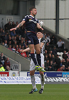Melvin De Leeuw gets higher than Jim Goodwin in the St Mirren v Ross County Scottish Professional Football League Premiership match played at St Mirren Park, Paisley on 3.5.14.
