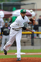 Edwin Diaz #45 of the Clinton LumberKings throws out runner at first base against the Kane County Cougars at Ashford University Field on July 5, 2014 in Clinton, Iowa. The Cougars won 4-0.   (Dennis Hubbard/Four Seam Images)