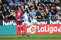 29th February 2020; Estadio Municipal de Butarque, Madrid, Spain; La Liga Football, Club Deportivo Leganes versus Deportivo Alaves; Miguel Angel Guerrero (CD Leganes)  wins the header from Rodrigo Ely (Deportivo Alaves)