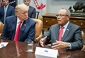 General Arthur T. Dean, Community Anti-Drug Coalitions of America, right, makes a statement at the invitation of United States President Donald J. Trump, left, who a few minutes earlier announced a grant for drug-free communities support program in the Roosevelt Room of the White House in Washington, DC on Wednesday, August 29, 2018.  Following his remarks the President took a few questions from the press.<br /> Credit: Ron Sachs / CNP