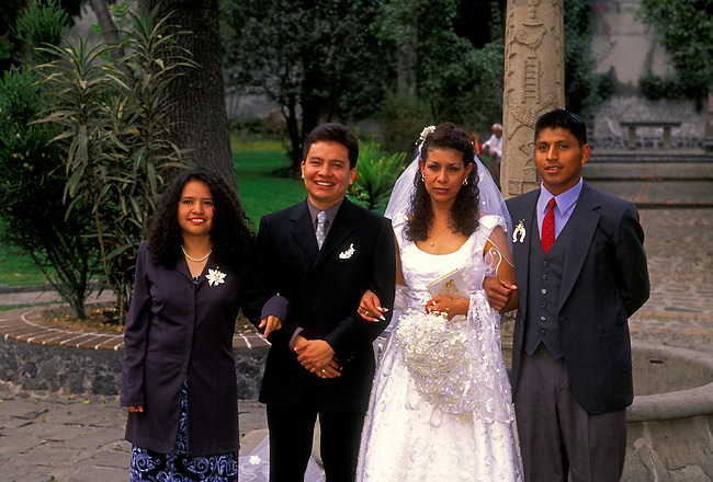 Bride, groom and guests in courtyard at San Jacinto Church, San Angel, Mexico City, Distrito Federal, Mexico, North America