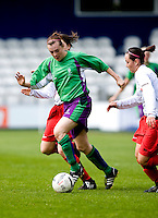 29 APR 2009 - LONDON,GBR - Emily Heckler - Leeds Met Carnegie (green and purple) v Northumbria University (white and red) - BUCS Womens Football Championships '09. (PHOTO (C) NIGEL FARROW)