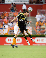 Columbus Crew forward Ricardo Virtuoso (25) heads the ball. The Houston Dynamo tied the Columbus Crew 1-1 in a regular season MLS match at Robertson Stadium in Houston, TX on August 25, 2007.