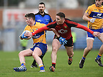 Keelan Sexton of  Clare in action against Aidan Carr of Down during their Division 2, Round 2 National League game at Cusack Park. Photograph by John Kelly.
