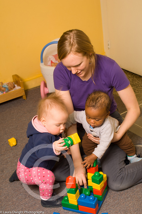 Day Care  Child Care infants female caregiver playing with two children
