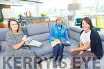 Carol McHugh (seated left) of Fitzgibbons Interiors chats with Nora Quirke and Kathleen Scannell at the opening of Fitzgibbons Interiors on Monday.