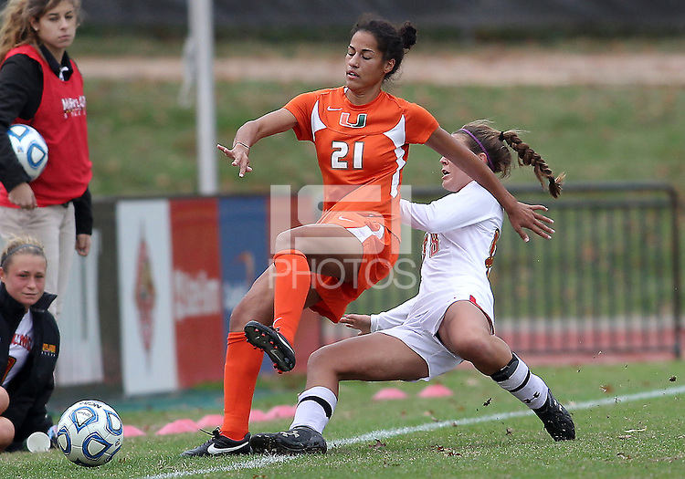 COLLEGE PARK, MD - OCTOBER 28, 2012:  Aubrey Baker (3) of the University of Maryland slides into Maddie Simms (21) of Miami during an ACC  women's tournament 1st. round match at Ludwig Field in College Park, MD. on October 28. Maryland won 2-1 on a golden goal in extra time.