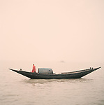 A fisherman in the icy winter breeze gets ready to go out fishing in the Sunderbans, Bangladesh 2014.