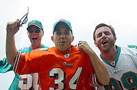Miami Dolphins fans cheer as the Miami Dolphins beat the Jacksonville Jaguars 14-10 at Jacksonville Municipal Stadium in Jacksonville, FL, December 13, 2009.  (Photo by Brian Cleary/www.bcpix.com)