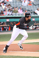 Miami Marlins left fielder Christian Yelich (76) hustles down the first base line against the Houston Astros during a spring training game at the Roger Dean Complex in Jupiter, Florida on March 12, 2013. Houston defeated Miami 9-4. (Stacy Jo Grant/Four Seam Images)........