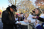 Country Singer Trace Atkins signs for fans as he participates at the 86th Annual Macy's Thanksgiving Day Parade on November 22, 2012 in New York City, New York. (Photo by Sue Coflin/Max Photos)