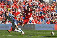 David Brooks of Wales (R) is fouled by David Hancko of Slovakia (L) during the UEFA EURO 2020 Qualifier match between Wales and Slovakia at the Cardiff City Stadium, Cardiff, Wales, UK. Sunday 24 March 2019