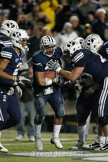 Trent Nelson  |  The Salt Lake Tribune.BYU running back Joshua Quezada (20) celebrates his second half touchdown,  BYU vs. New Mexico, Saturday, November 20, 2010.