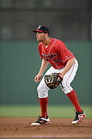 First baseman Triston Casas (38) of the Greenville Drive, the Boston Red Sox No. 2 prospect, playing as the Energia in MiLB's Copa de la Diversion, plays defense in a game against the Augusta GreenJackets at Fluor Field at the West End in Greenville, South Carolina. Augusta won, 9-8. (Tom Priddy/Four Seam Images)