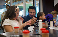 NWA Democrat-Gazette/CHARLIE KAIJO Sophia Luna 9, (left) and  Ángel Luna of Springdale react after trying a chocolate drink they made in the Hershey's Lab during the Zing in The New Year! event on Sunday, December 31, 2017 at Amazeum in Bentonville. Visitors wrote down New Year's wishes and made party hats and noise makers  and enjoyed the general activities