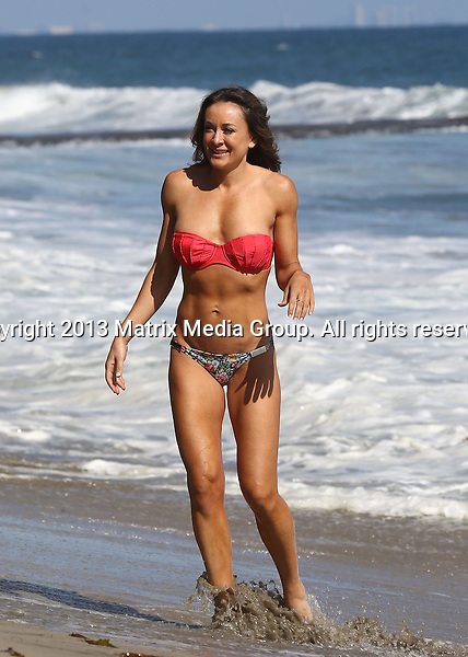 31 JULY 2013 MALIBU USA<br /> <br /> EXCLUSIVE PICTURES<br /> <br /> Michelle Bridges pictured showing off her toned bikini body at Malibu Beach.<br /> <br /> *No internet without clearance*<br /> MUST CALL PRIOR TO USE .<br /> +61 2 9211-1088<br /> Matrix Media Group<br /> Note: All editorial images subject to the following: For editorial use only. Additional clearance required for commercial, wireless, internet or promotional use.Images may not be altered or modified. Matrix Media Group makes no representations or warranties regarding names, trademarks or logos appearing in the images.