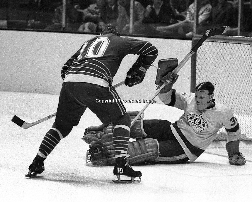 Los Angeles Kings goalie Wayne Rutledge blocks shot by California Golden Seal Ted Hampson                (1969 photo by Ron Riesterer)