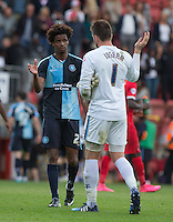 Sido Jombati of Wycombe Wanderers & Goalkeeper Matt Ingram of Wycombe Wanderers embrace at the final whistle during the Sky Bet League 2 match between Leyton Orient and Wycombe Wanderers at the Matchroom Stadium, London, England on 19 September 2015. Photo by Andy Rowland.
