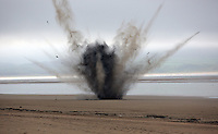 Pictured: The device is detonated at Cefn Sidan beach, near Pembrey west Wales, UK. Saturday 21 May 2016<br />