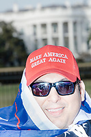 Eric Villacis, 41, of Atlanta, Georgia, wears a Make America Great Again hat as he poses for pictures outside the White House in Washington, D.C., on Jan. 19, 2017, the day before the inauguration of president-elect Donald Trump.