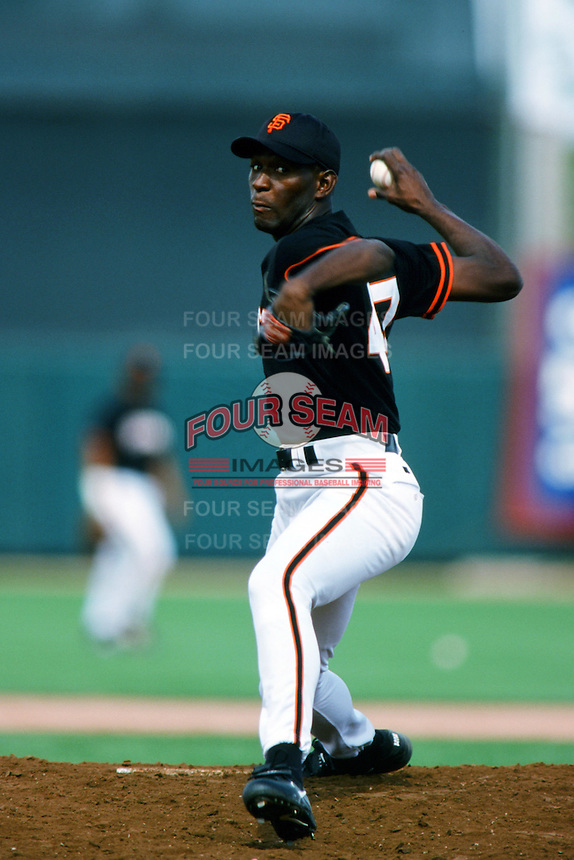 Felix Rodriguez of the San Francisco Giants pitches during a 1999 Major League Baseball Spring Training Game in Phoenix, Arizona. (Larry Goren/Four Seam Images)