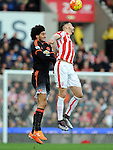 Marouane Fellaini of Manchester United is challenged by Geoff Cameron of Stoke City<br /> - Barclays Premier League - Stoke City vs Manchester United - Britannia Stadium - Stoke on Trent - England - 26th December 2015 - Pic Robin Parker/Sportimage