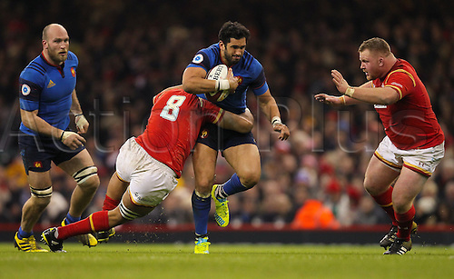26.02.2016. Principality Stadium, Cardiff, Wales. RBS Six Nations Championships. Wales versus France. France's Maxime Mermoz is tackled by Wales Taulupe Faletau